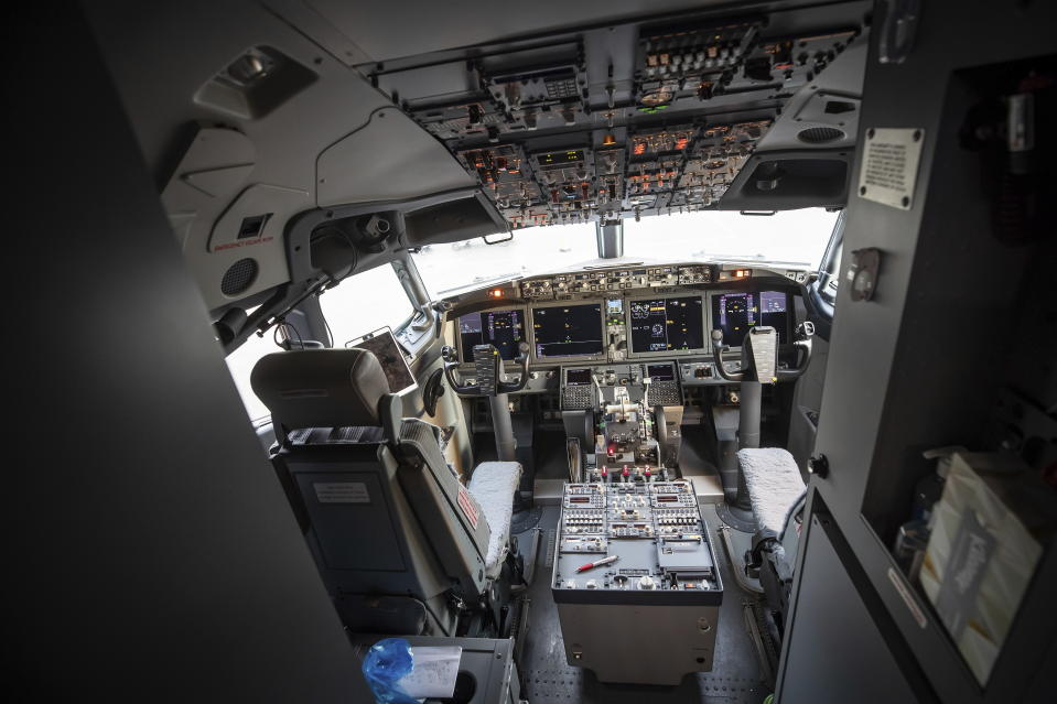 The flight deck of a WestJet Airlines Boeing 737 Max aircraft is seen after arriving at Vancouver International Airport in Richmond, B.C., on Thursday, Jan.  21, 2021. The flight from Calgary was the first commercial Boeing 737 Max flight in Canada since the aircraft was grounded worldwide in 2019 following two deadly crashes.  (Darryl Dyck/The Canadian Press via AP)