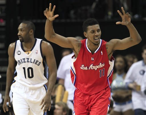 Los Angeles Clippers guard Nick Young (11) celebrates after hitting a three-point basket as Memphis Grizzlies guard Gilbert Arenas (10) follows him downcourt in the second half of Game 7 in a first-round NBA basketball playoff series on Sunday, May 13, 2012, in Memphis, Tenn. The Clippers won 82-72 to take the series 4-3. (AP Photo/Mark Humphrey)