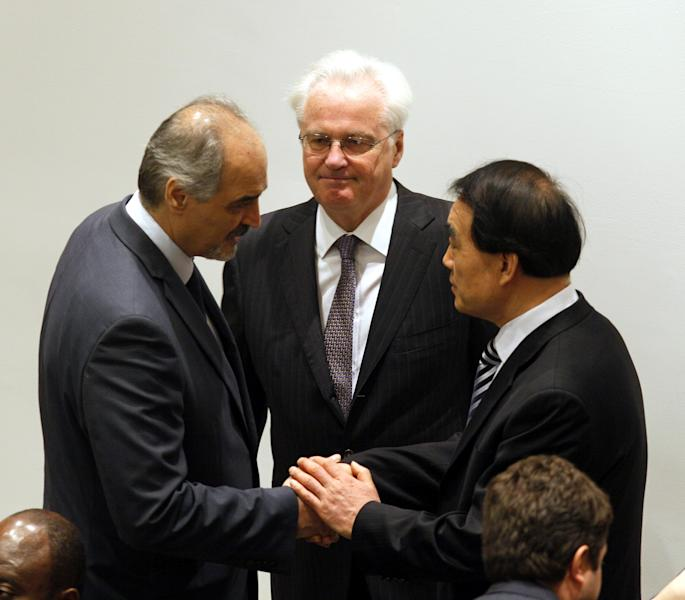 Bashar Jaafari, left, Syrian Ambassador to United Nations shakes hands with Li Baodong, right, Chinese Ambassador to UN with Vitaly Churkin, Russian Ambassador, center, before members of the Security Council of United Nations voted unanimously to adopt Syria Observer Mission Resolution authorizing 300 observers to be sent to Syria, Saturday, April 21 ,2012. (AP Photo/David Karp)