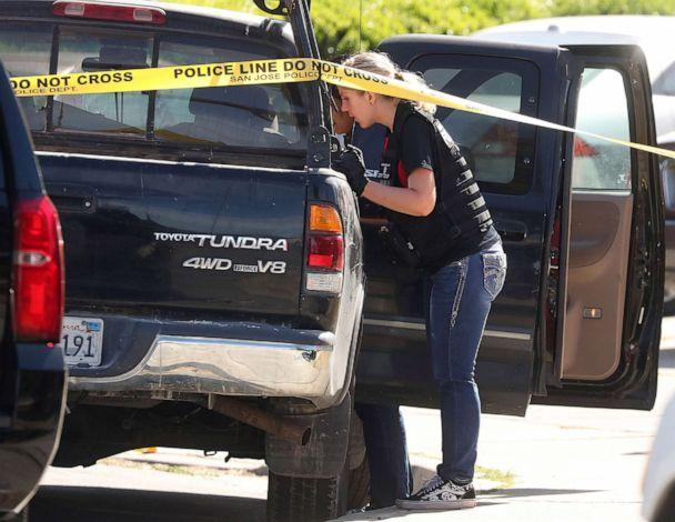 PHOTO: A forensic analyst with the San Jose Police Department searches a truck near scene where five people were killed Monday, June 24, 2019, in San Jose, Calif. (Aric Crabb/Bay Area News Group via AP)