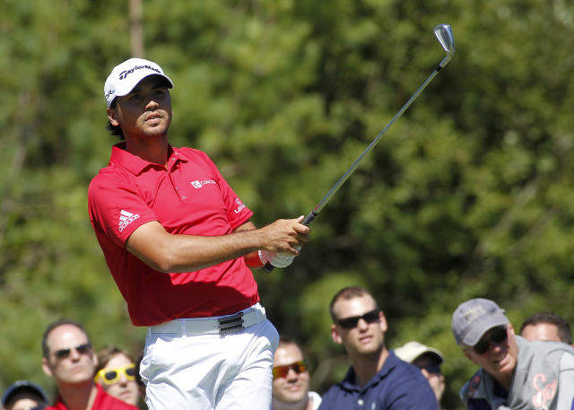 Jason Day, of Australia, watches his tee shot on the third hole during the second round of the Deutsche Bank Championship golf tournament in Norton, Mass., Saturday, Aug. 30, 2014. (AP Photo/Stew Milne)
