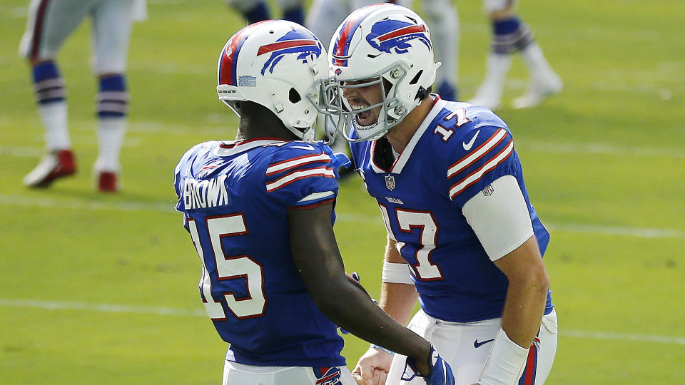MIAMI GARDENS, FLORIDA - SEPTEMBER 20: Josh Allen #17 of the Buffalo Bills celebrates with John Brown #15 after a 46-yard touchdown during the fourth quarter at Hard Rock Stadium on September 20, 2020 in Miami Gardens, Florida. (Photo by Michael Reaves/Getty Images)