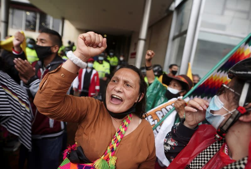 Demonstrators gather outside a local hotel where representatives of the Inter-American Commission on Human Rights (CIDH) and union leaders meet, in Bogota
