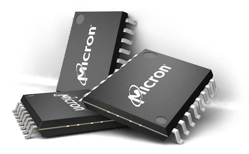 Three semiconductor chips with Micron logo imprinted on them.