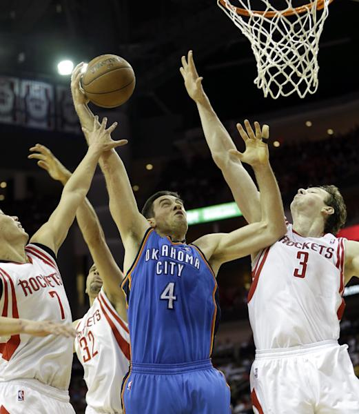 Oklahoma City Thunder's Nick Collison (4) goes up for a shot as Houston Rockets' Omer Asik (3), Francisco Garcia (32) and Jeremy Lin (7) defend during the second quarter of Game 3 in a first-round NBA basketball playoff series Saturday, April 27, 2013, in Houston. (AP Photo/David J. Phillip)