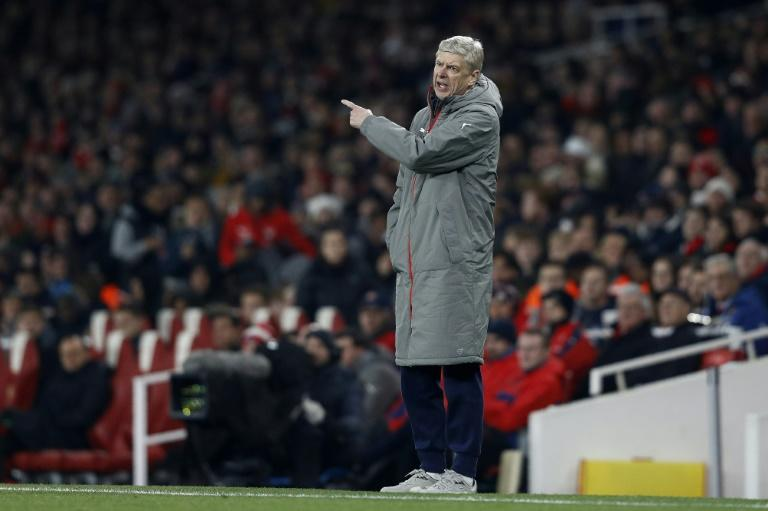 Arsenal's manager Arsene Wenger shouts instructions to his players from the touchline during the EFL (English Football League) Cup quarter-final football match between Arsenal and Southampton on November 30, 2016