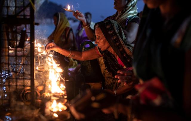 Hindu devotees light oil lamps at a temple after Supreme Court's verdict on a disputed religious site, in Ayodhya, India, November 9, 2019. REUTERS/Danish Siddiqui