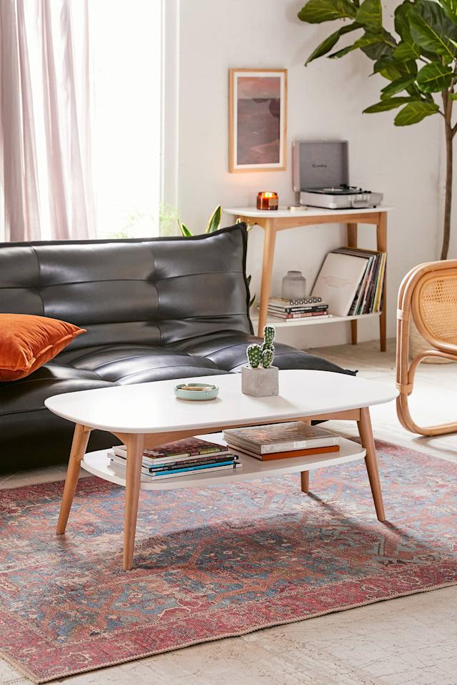 "<p>We're into the extra shelf on this <a href=""https://www.popsugar.com/buy/Otis-Coffee-Table-412654?p_name=Otis%20Coffee%20Table&retailer=urbanoutfitters.com&pid=412654&price=179&evar1=casa%3Aus&evar9=45867877&evar98=https%3A%2F%2Fwww.popsugar.com%2Fhome%2Fphoto-gallery%2F45867877%2Fimage%2F46654250%2FOtis-Coffee-Table&list1=shopping%2Chome%20decor%2Cfurniture%2Chome%20shopping&prop13=api&pdata=1"" rel=""nofollow"" data-shoppable-link=""1"" target=""_blank"" class=""ga-track"" data-ga-category=""Related"" data-ga-label=""https://www.urbanoutfitters.com/shop/otis-coffee-table?category=furniture&amp;color=010&amp;type=REGULAR"" data-ga-action=""In-Line Links"">Otis Coffee Table</a> ($179, originally $189) for books and magazines.</p>"