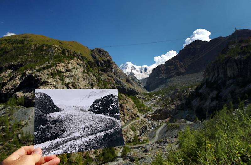 A handout picture of the Gorner Glacier taken in 1863 in Zermatt, Switzerland and released by ETH Library Zurich, is seen displayed at the same location on Aug. 25, 2019. (Photos: Denis Balibouse / Reuters, Glaziologische Kommission der Akademie der Naturwissenschaften Schweiz/ETH Library Zurich/Handout via Reuters)