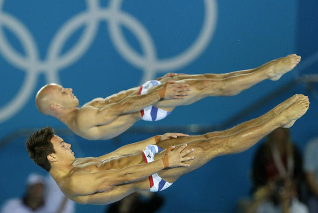 <p> Thomas Daley, front, and Peter Waterfield, rear, from Great Britain compete during the Men's Synchronized 10 Meter Platform Diving final at the Aquatics Centre in the Olympic Park during the 2012 Summer Olympics in London, Monday, July 30, 2012. (AP Photo/Michael Sohn) </p>