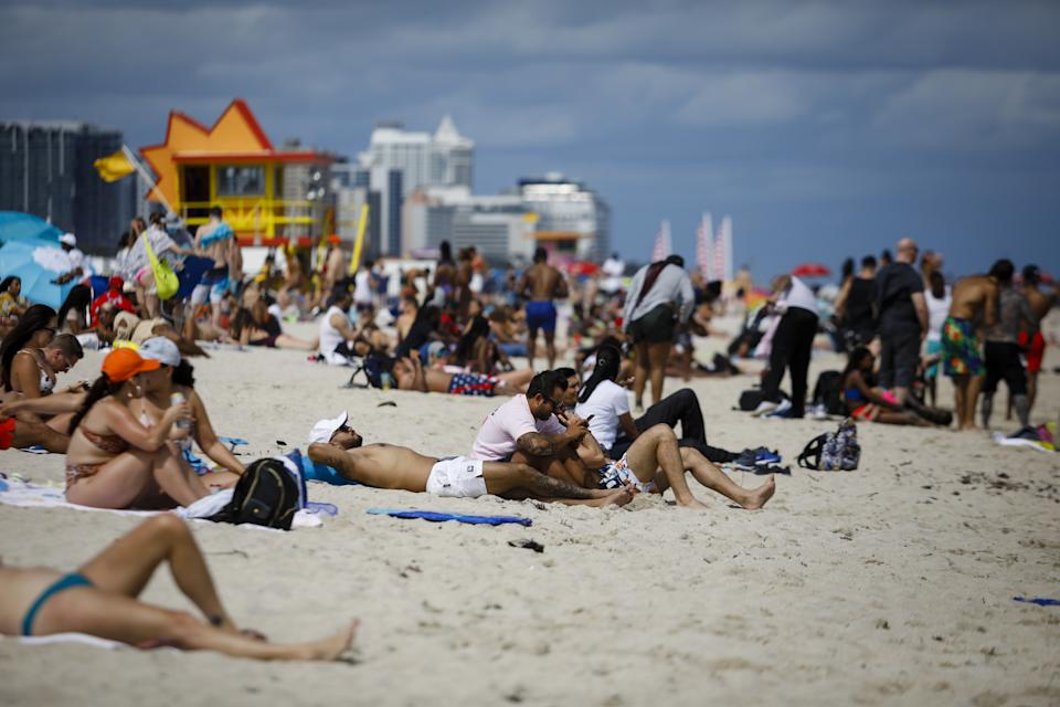 Beachgoers gather in Miami Beach, Fla., earlier this month. As spring break begins at many schools nationwide, experts weigh in on what is and isn't safe. (Eva Marie Uzcategui/Bloomberg)