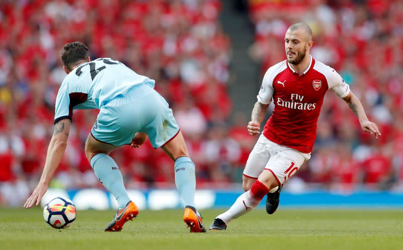FILE PHOTO: Jack Wilshere, right, in action for Arsenal against Burnley in 2018