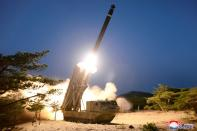 A view shows the testing of what local media call a super-large multiple rocket launcher in North Korea