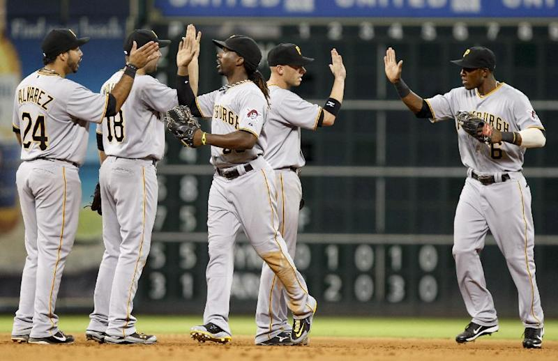 The Pittsburgh Pirates celebrate their win over the Houston Astros following the ninth inning of a baseball game Saturday, July 28, 2012 in Houston. (AP Photo/Eric Kayne)