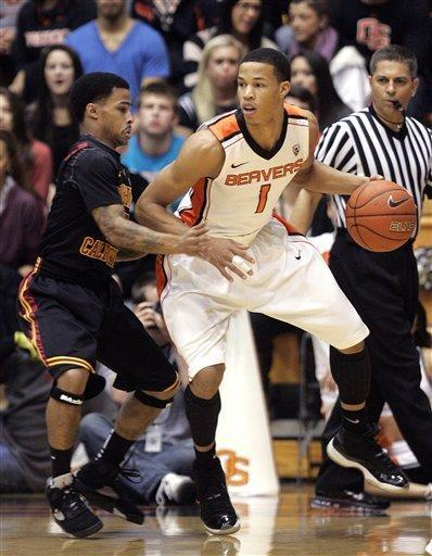 Oregon State guard Jared Cunningham, right, maneuvers against Southern California guard Maurice Jones during the first half of an NCAA college basketball game in Corvallis, Ore., Saturday, Jan. 21, 2012. (AP Photo/Don Ryan)