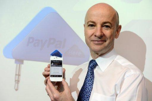 Senior Vice President of Asia Pacific for Paypal, Rupert Keeley, poses for a picture with Paypal's triangle-shaped smartphone payment dongle in Hong Kong, on March 16. Online financial transactions titan PayPal has started to allow merchants across the world to take payments using smartphones in a direct challenge to startup Square