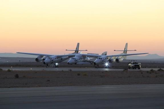 Virgin Galactic's first SpaceShipTwo passenger spaceliner and its WhiteKnightTwo carrier craft prepare to take off on the fourth rocket-powered flight test of the spacecraft on Oct. 31, 2014 at the Mojave Air and Space Port in California.