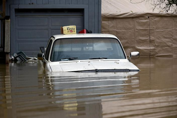 A pickup truck is seen submerged in flood waters from the Russian River in Forestville, Calif., on Feb. 27, 2019. (Photo: Michael Short/AP)