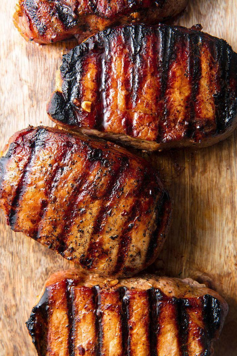 """<p>These <a href=""""https://www.delish.com/uk/cooking/recipes/a28826183/best-pork-chop-marinade-recipe/"""" rel=""""nofollow noopener"""" target=""""_blank"""" data-ylk=""""slk:pork chops"""" class=""""link rapid-noclick-resp"""">pork chops</a> are marinated to make them extra flavourful and tender. </p><p>Get the <a href=""""https://www.delish.com/uk/cooking/recipes/a32152630/best-grilled-pork-chops-recipe/"""" rel=""""nofollow noopener"""" target=""""_blank"""" data-ylk=""""slk:Honey Soy Grilled Pork Chops"""" class=""""link rapid-noclick-resp"""">Honey Soy Grilled Pork Chops</a> recipe.</p>"""