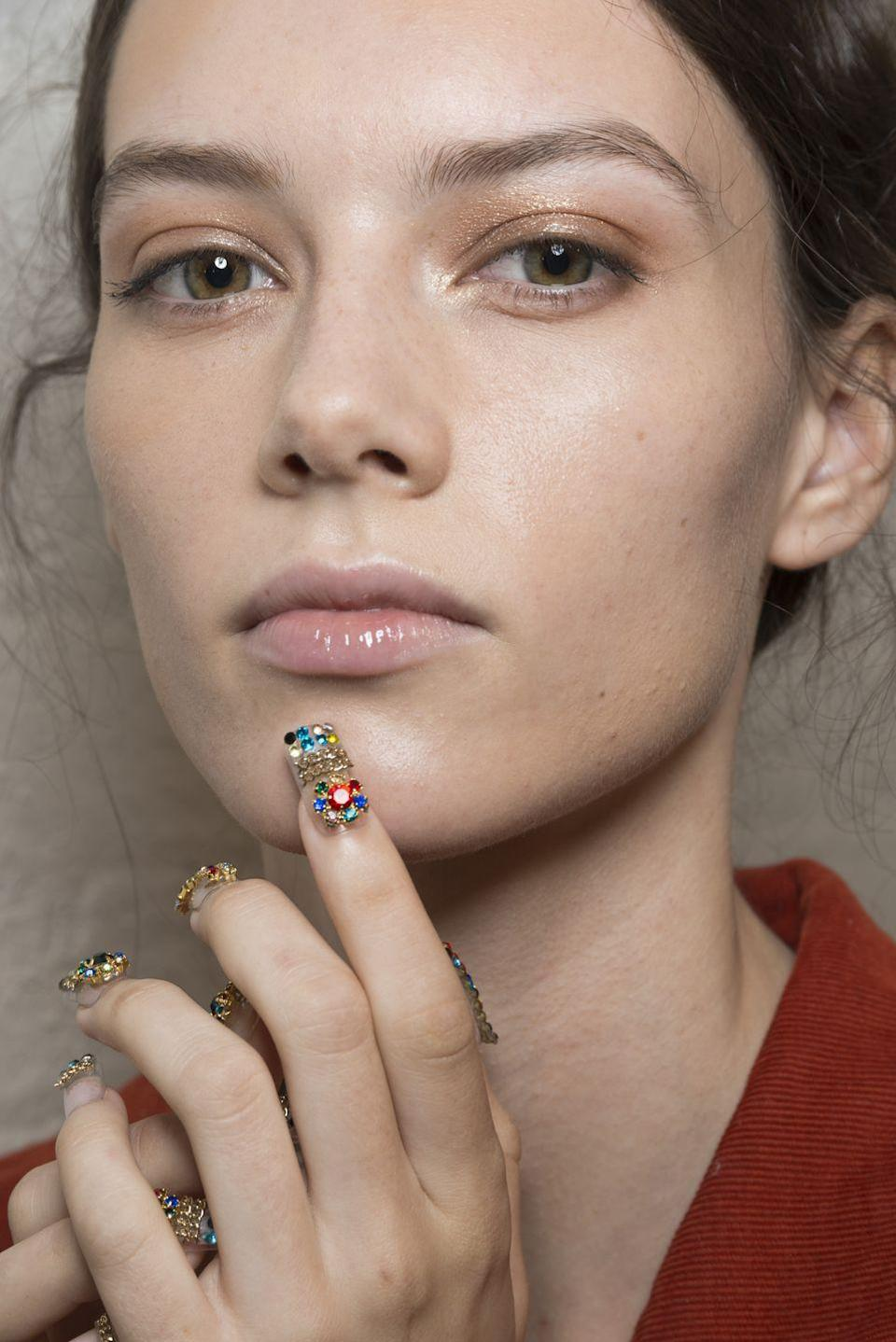<p>A sheer bronze eye and glossy lip were the perfect neutral base for the bedazzled nails at Adeam.</p>