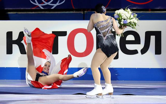 Figure Skating - World Figure Skating Championships - The Mediolanum Forum, Milan, Italy - March 23, 2018 Japan's silver medalist Wakaba Higuchi reacts as Canada's gold medalist Kaetlyn Osmond tumbles as they celebrate after the Ladies Free Skating REUTERS/Alessandro Bianchi
