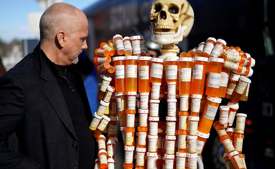 Frank Huntley looks at his sculpture made out of the opioid pill bottles he got when addicted, set up outside Democratic presidential candidate and former Vice President Joe Biden's campaign event in Somersworth, New Hampshire, U.S., February 5, 2020. REUTERS/Rick Wilking