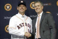FILE - In this Sept. 29, 2014, file photo, Houston Astros general manager Jeff Luhnow, right, and A.J. Hinch pose after Hinch is introduced as the new manager of the baseball club in Houston. Hinch and Luhnow were fired Monday, Jan. 13, 2020, after being suspended for their roles in the team's extensive sign-stealing scheme from 2017. (AP Photo/Pat Sullivan, File)
