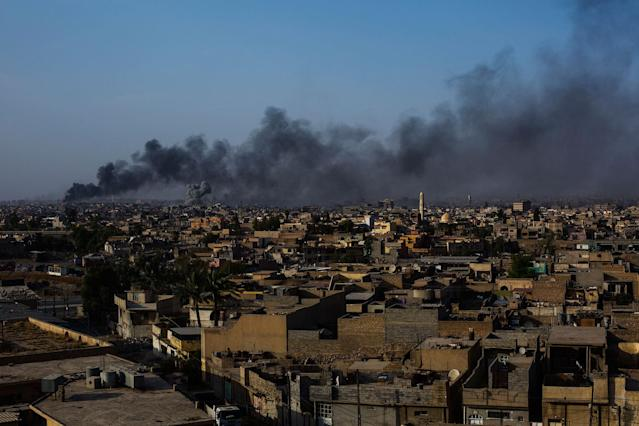 <p>A view of the old city of Mosul on fire after an ISIS counterattack along the northern edge of Mosul's Old City neighborhood. July 7, 2017. Mosul. Iraq. (Photograph by Diego Ibarra Sánchez / MeMo) </p>