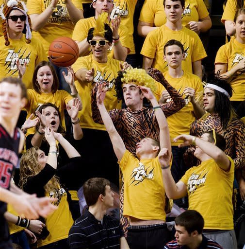 Missouri fans try to catch a ball as it flies into the stands during the first half of an NCAA college basketball game against Texas Tech Saturday, Jan. 28, 2012, in Columbia, Mo. Missouri won the game 63-50. (AP Photo/L.G. Patterson)