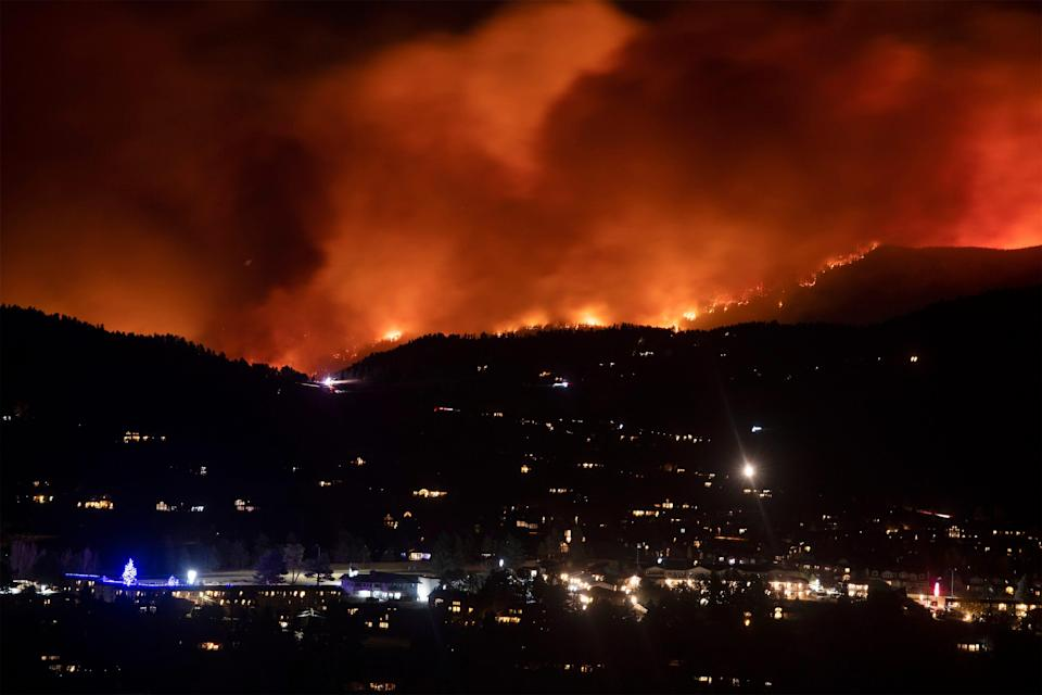 Flames from the Cameron Peak Fire, the largest wildfire in Colorado history, burn trees along a ridge outside Estes Park, Colo., on Oct. 16, 2020.