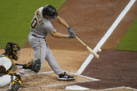 Pittsburgh Pirates' Bryan Reynolds hits an RBI double during the third inning of a baseball game against the San Diego Padres, Tuesday, May 4, 2021, in San Diego. (AP Photo/Gregory Bull)