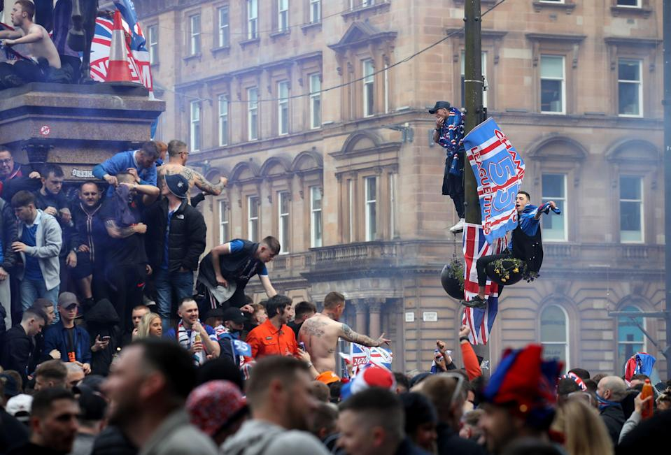 Rangers fans celebrate in George Square, Glasgow, despite the city still being in Scotland's level 3 of lockdownPA