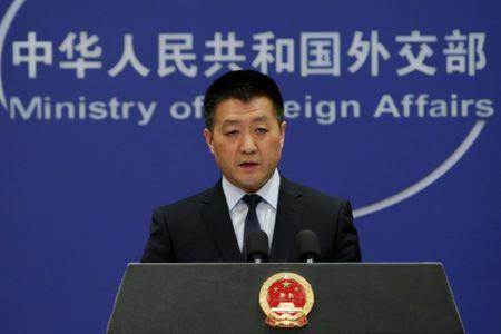 FILE PHOTO: Chinese Foreign Ministry spokesman Lu Kang answers questions about a major bus accident in North Korea, during a news conference in Beijing