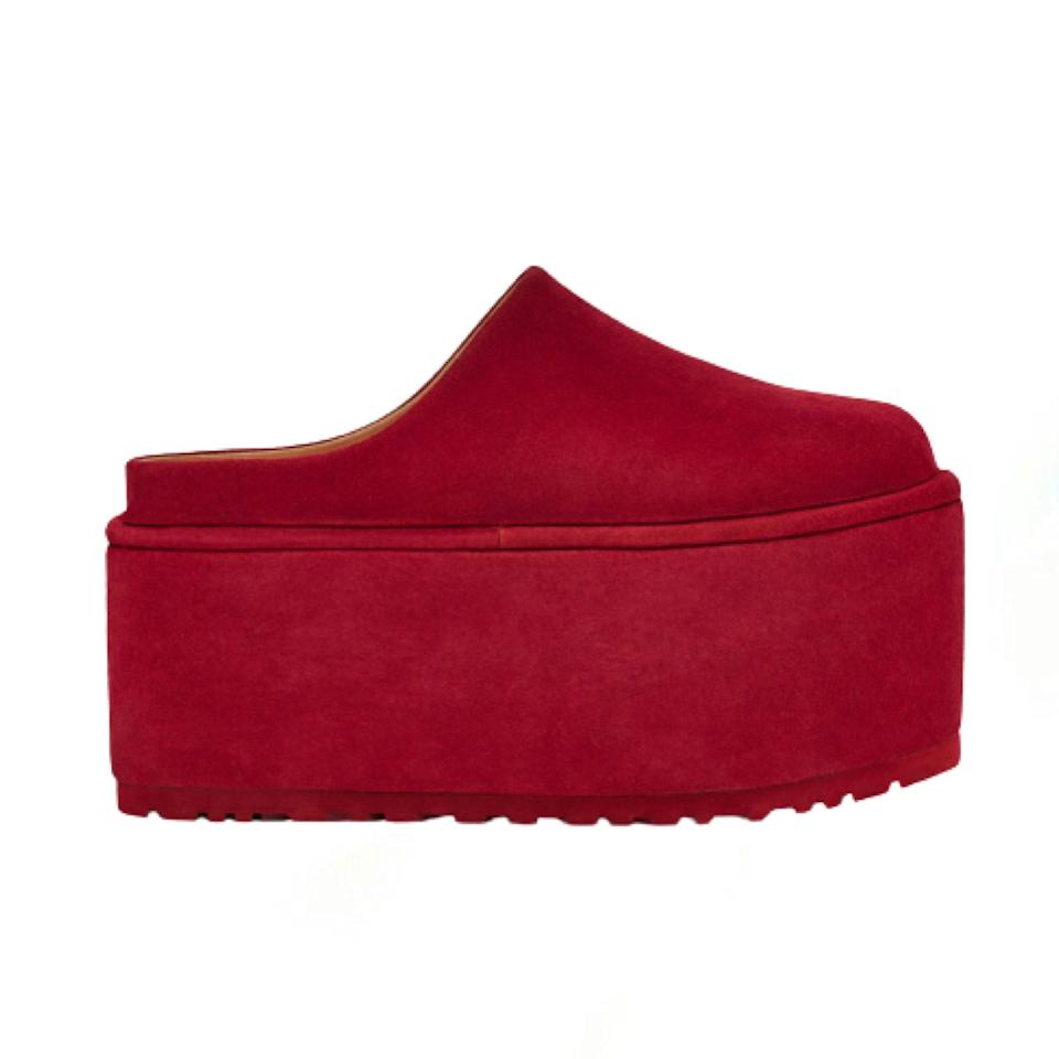 """Ever wonder what an extreme version of a slip on mule would look like? It's the Ugg x Molly Goddard Platform, which features a two-inch sole and comes in red, green, and navy. If you're short, you can just slip these on anytime you need to get a book off of a shelf. $420, Ugg. <a href=""""https://www.ugg.com/molly-goddard/ugg-x-molly-goddard-platform/1123970.html"""" rel=""""nofollow noopener"""" target=""""_blank"""" data-ylk=""""slk:Get it now!"""" class=""""link rapid-noclick-resp"""">Get it now!</a>"""
