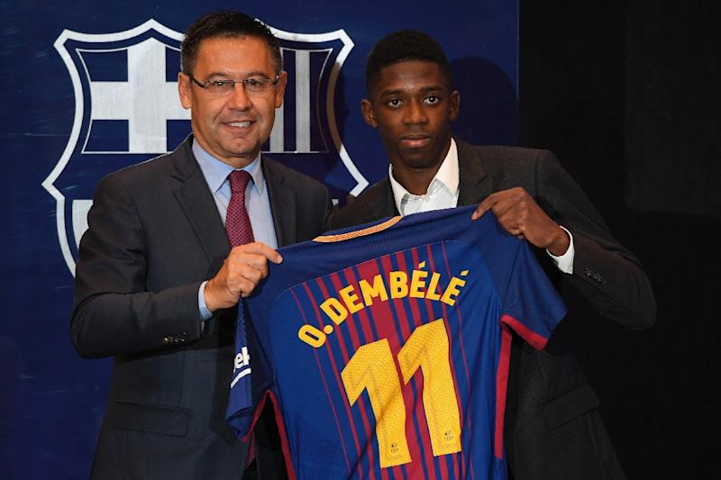 62defe96f47 Barcelona's new player Ousmane Dembele (R) poses with his new