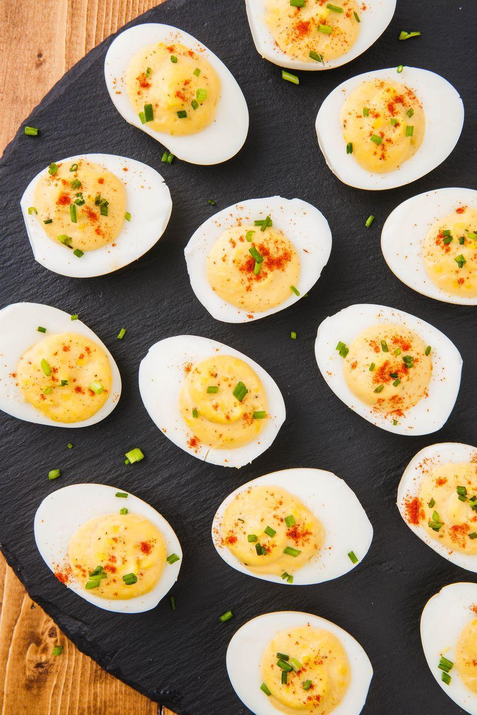 """<p>If you're team <a href=""""https://www.delish.com/cooking/g10/deviled-eggs/"""" rel=""""nofollow noopener"""" target=""""_blank"""" data-ylk=""""slk:deviled eggs"""" class=""""link rapid-noclick-resp"""">deviled eggs</a>, this is the only recipe you'll ever need.</p><p>Get the recipe from <a href=""""https://www.delish.com/cooking/recipe-ideas/a51851/classic-deviled-eggs-recipe/"""" rel=""""nofollow noopener"""" target=""""_blank"""" data-ylk=""""slk:Delish"""" class=""""link rapid-noclick-resp"""">Delish</a>.</p>"""