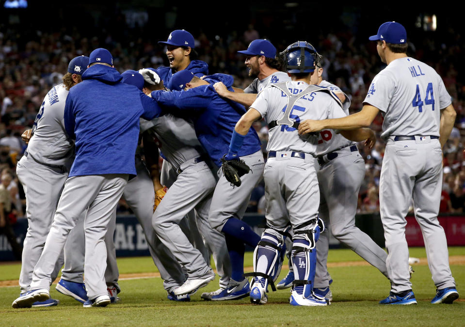 The Los Angeles Dodgers celebrate after game 3 of baseball's National League Division Series against the Arizona Diamondbacks, Monday, Oct. 9, 2017, in Phoenix. The Dodgers won 3-1 to advance to the National League Championship Series. (AP)