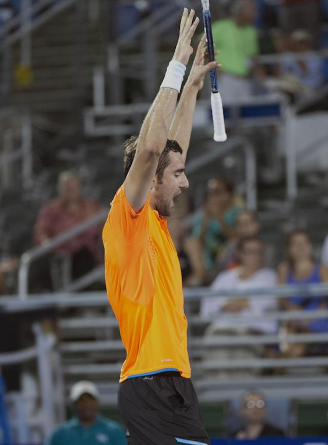 Marinn Cilic, of Croatia, celebrates after defeating Kevin Anderson in the Delray Beach Open tennis tournament, Sunday, Feb. 23, 2014, in Delray Beach, Fla. Cilic won 7-6 (6), 6-7 (7), 6-4. (AP Photo/J Pat Carter)