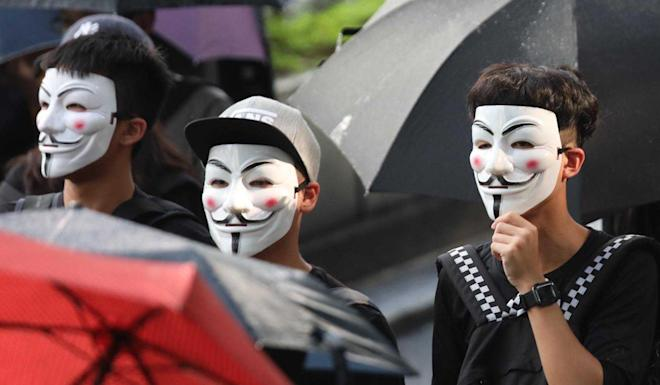 Protesters march with masks on. Photo: Xiaomei Chen