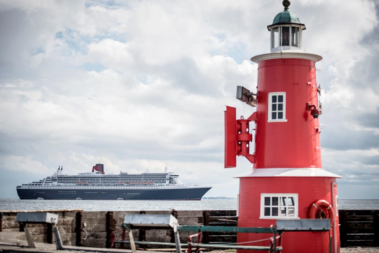 Queen Mary 2 cruise ship is anchored near to Elsinore, Denmark, August 14, 2018. Mads Claus Rasmussen/Ritzau Scanpix/via REUTERS    ATTENTION EDITORS - THIS IMAGE WAS PROVIDED BY A THIRD PARTY. DENMARK OUT. NO COMMERCIAL OR EDITORIAL SALES IN DENMARK.