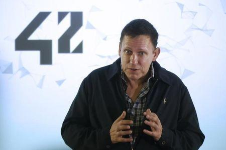 Peter Thiel, the Silicon Valley investor who co-founded PayPal talks to students during his visit to the 42 school campus in Paris, France, February 24, 2016. REUTERS/Jacky Naegelen
