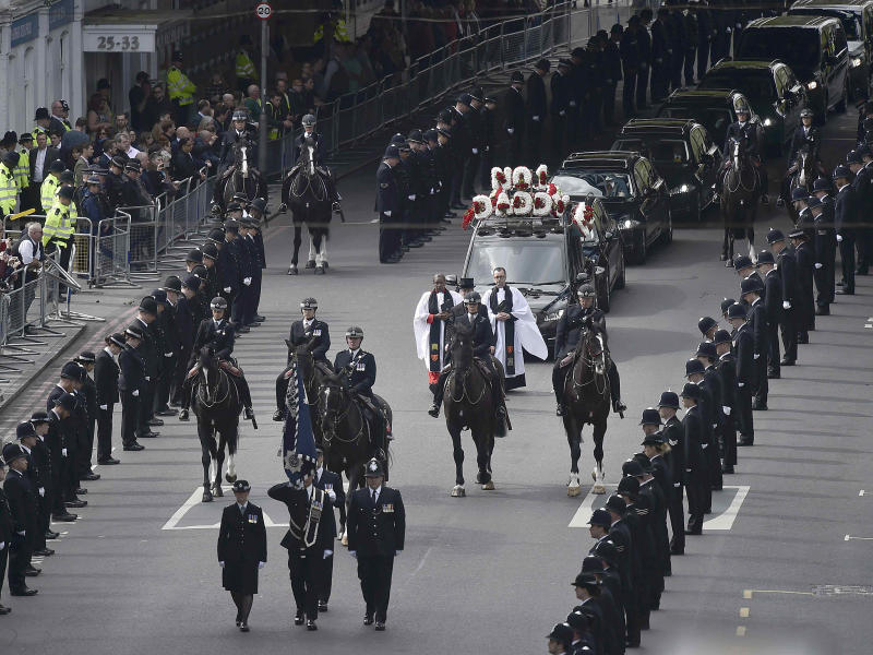 Thousands of police officers lined the two mile route of PC Keith Palmer's funeral cortege through central London: Reuters