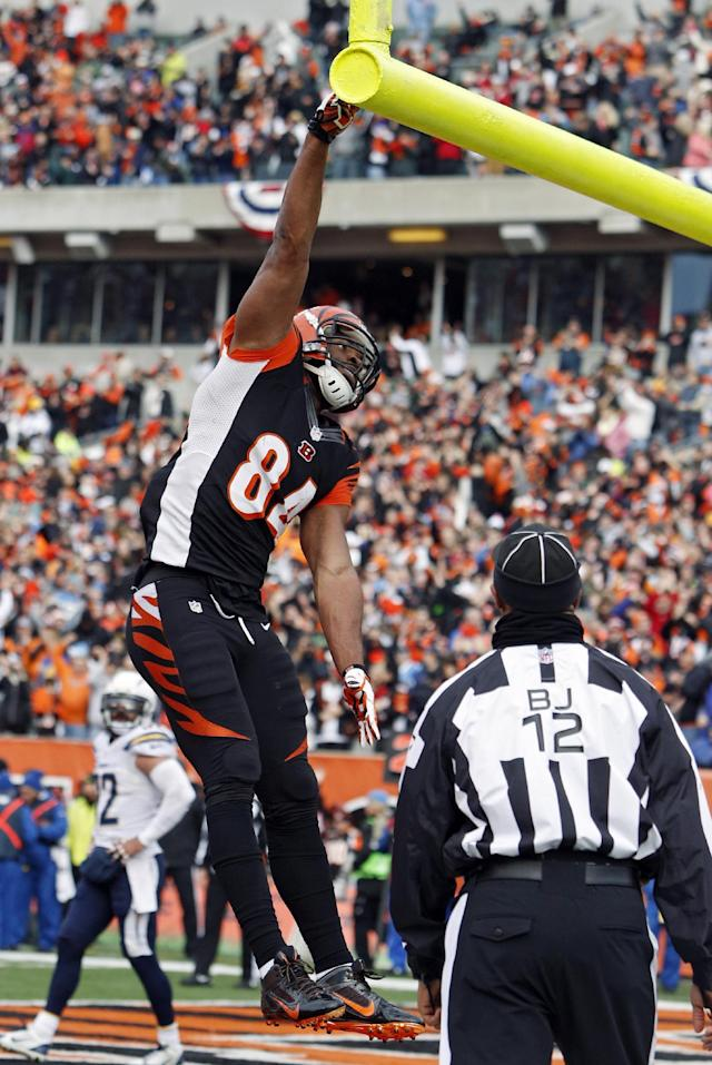Cincinnati Bengals tight end Jermaine Gresham celebrates his four-yard touchdown catch against the San Diego Chargers in the first half of an NFL wild-card playoff football game on Sunday, Jan. 5, 2014, in Cincinnati. (AP Photo/David Kohl)