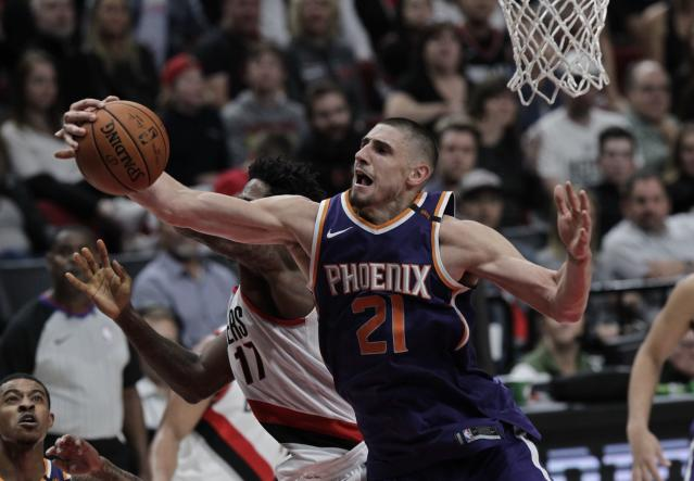"<a class=""link rapid-noclick-resp"" href=""/nba/teams/pho/"" data-ylk=""slk:Phoenix Suns"">Phoenix Suns</a> center <a class=""link rapid-noclick-resp"" href=""/nba/players/5156/"" data-ylk=""slk:Alex Len"">Alex Len</a> is a solid add if you're in need of rebounding. (AP Photo/Steve Dipaola)"