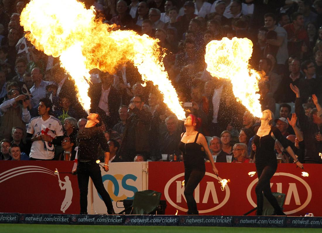 The crowd are entertained by fire eaters during the first T20 International cricket match between England and New Zealand at The Oval cricket ground in London on June 25, 2013. AFP PHOTO / IAN KINGTON