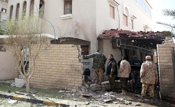 Libyan security forces inspect the site of a bomb explosion at the entrance of the residence of the Iranian ambassador in the capital Tripoli on February 22, 2015 (AFP Photo/STR)