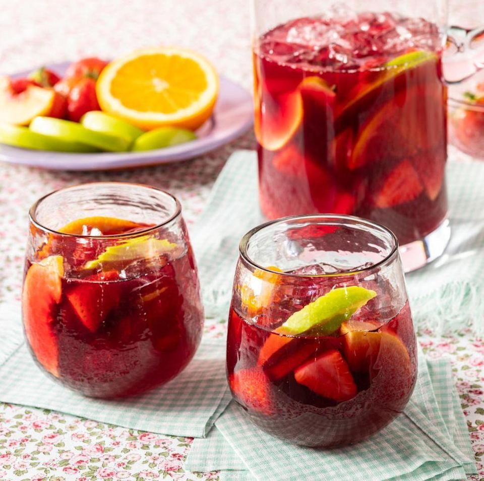 """<p>This classic cocktail is a no-brainer when it comes to serving a crowd. It's best made in advance in a big pitcher—and you can use whatever fruits you have on hand. Try strawberries, crisp apples, and blueberries for a play on red, white, and blue. </p><p><a href=""""https://www.thepioneerwoman.com/food-cooking/recipes/a35824488/red-sangria/"""" rel=""""nofollow noopener"""" target=""""_blank"""" data-ylk=""""slk:Get the recipe."""" class=""""link rapid-noclick-resp""""><strong>Get the recipe. </strong></a></p><p><a class=""""link rapid-noclick-resp"""" href=""""https://go.redirectingat.com?id=74968X1596630&url=https%3A%2F%2Fwww.walmart.com%2Fsearch%2F%3Fquery%3Dpioneer%2Bwoman%2Bpitchers&sref=https%3A%2F%2Fwww.thepioneerwoman.com%2Ffood-cooking%2Fmeals-menus%2Fg36432840%2Ffourth-of-july-drinks%2F"""" rel=""""nofollow noopener"""" target=""""_blank"""" data-ylk=""""slk:SHOP PITCHERS"""">SHOP PITCHERS</a></p>"""