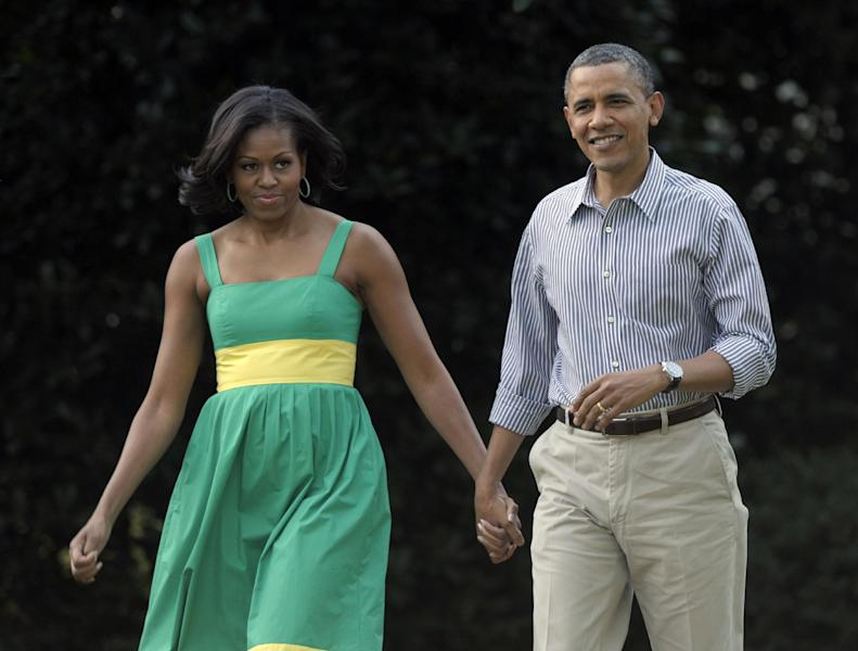 """FILE - In this June 27, 2012 file photo, President Barack Obama and his wife, Michelle, arrive at the Congressional picnic on the South Lawn of the White House in Washington. The Democratic president and first lady will tape an episode of """"The View"""" on Monday, Sept. 20, 2012 to air the next day, in their first joint appearance on the daytime show. GOP challenger Mitt Romney might not be far behind. (AP Photo/Susan Walsh, File)"""