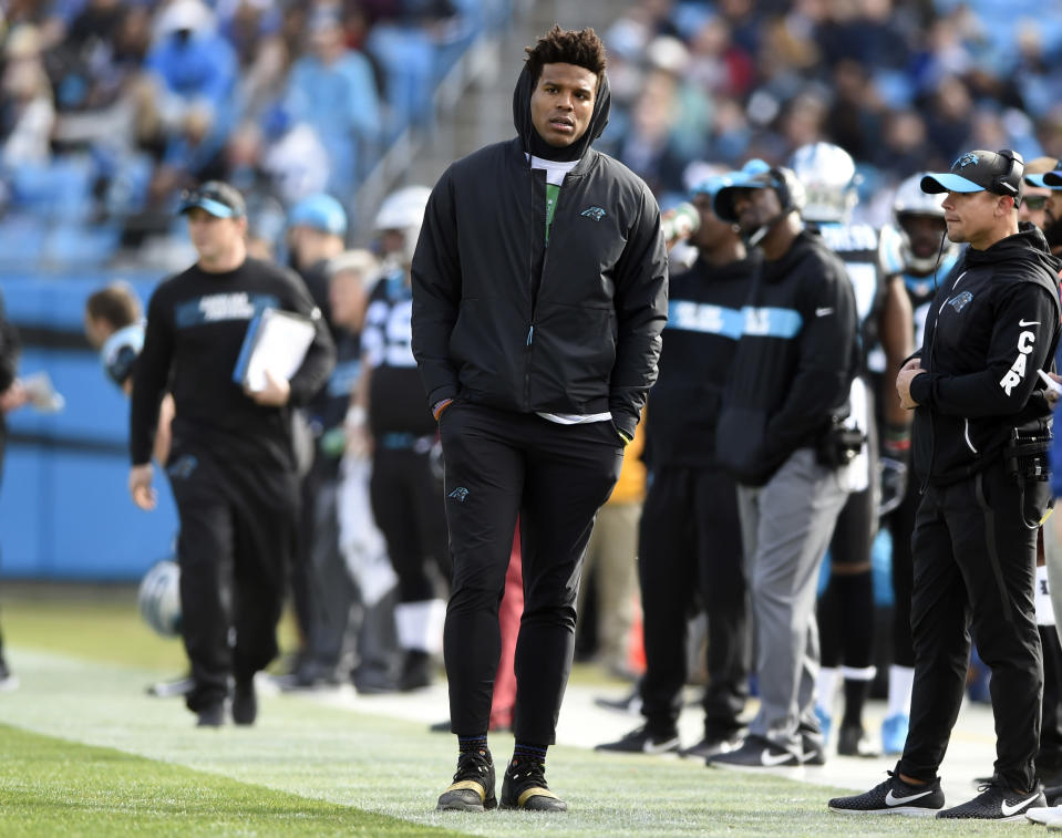 Cam Newton spent the last two games of the Panthers' season on the sideline. (AP Photo/Mike McCarn)