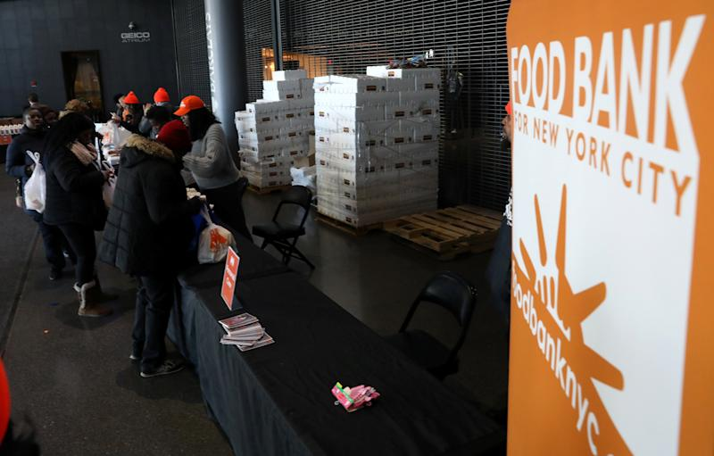 Employees receive donations at a food distribution center for federal workers impacted by the government shutdown, at the Barclays Center in the Brooklyn borough of New York